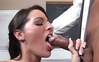 Teenage is in front of blackboard, getting her tight pussy gobbled