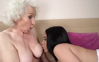 Old granny and beautiful black-haired woman make lesbian enjoy